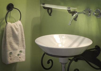 round white ceramic sink near white towel