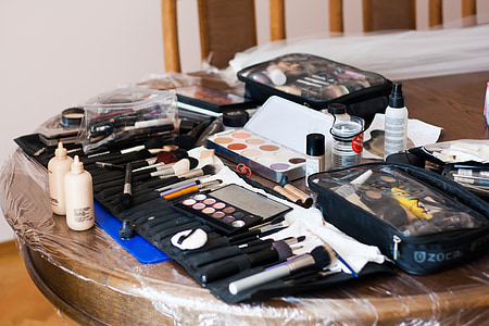 assorted-color cosmetic product lot on top of brown table