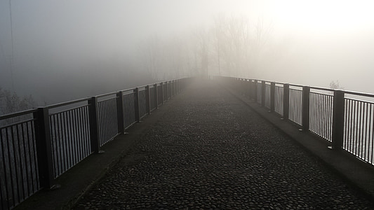 grey steel railing near foot bridge