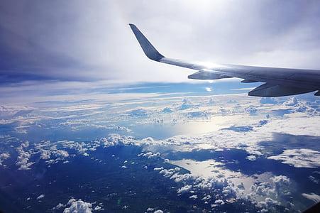 white plane flying during daytime