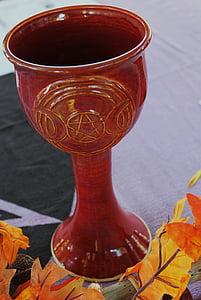 red ceramic chalice