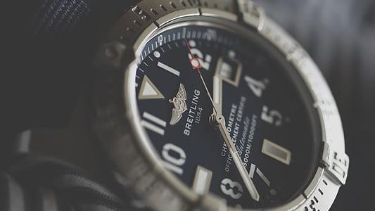 Breitling analog watch at 2:35 display