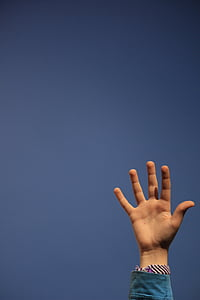person raising left hand