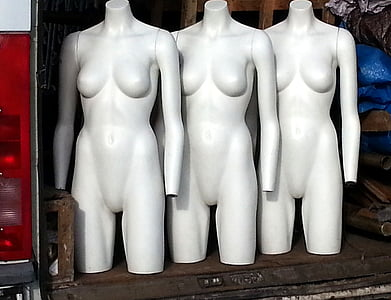 three white mannequins
