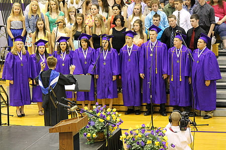 choir singing during graduation ceremony inside gymnasium