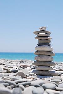 pile of stones beside sea