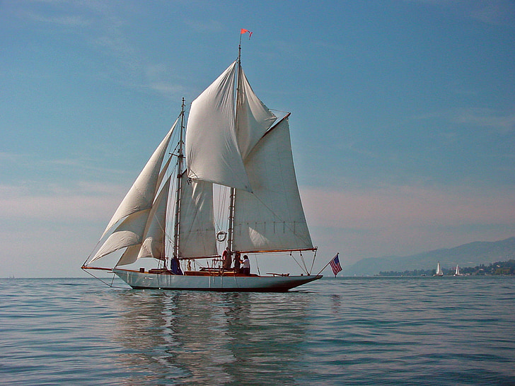 sailing boat on body of water during daytime