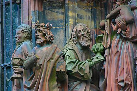 four man statues