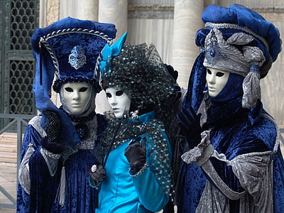 three person wearing blue traditional suits at daytime