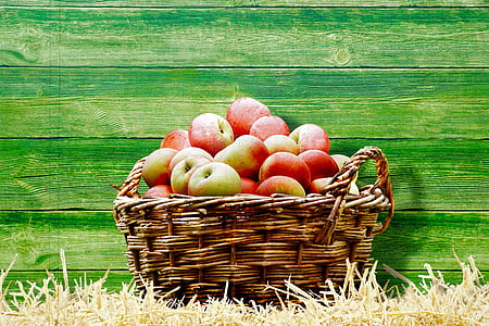 basket full of apples near wall