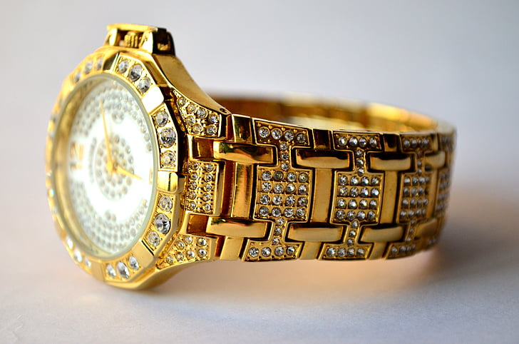 round gold-colored analog watch with gold-colored link bracelet