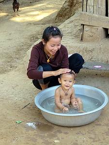 baby taking a bath on basin