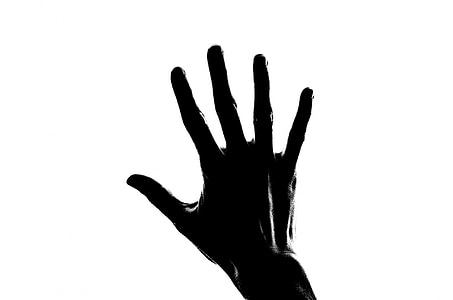 grayscale photography of right hand