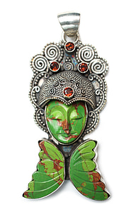 green and silver-colored Buddha pendant