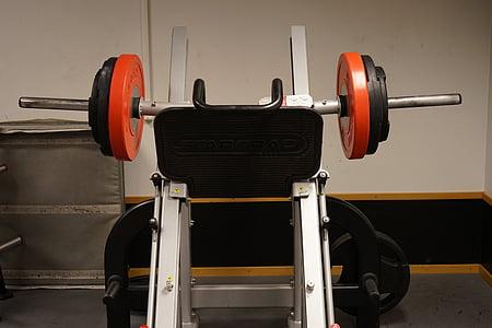 black, white, and orange bench press