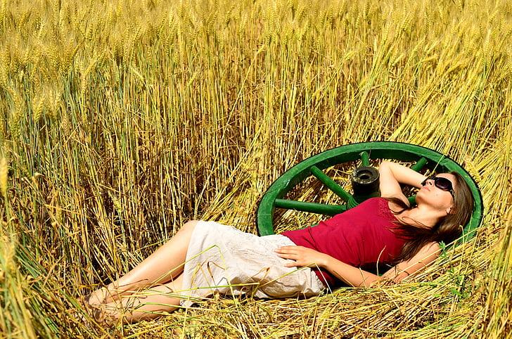Royalty-Free photo: Woman laying on a grass field | PickPik