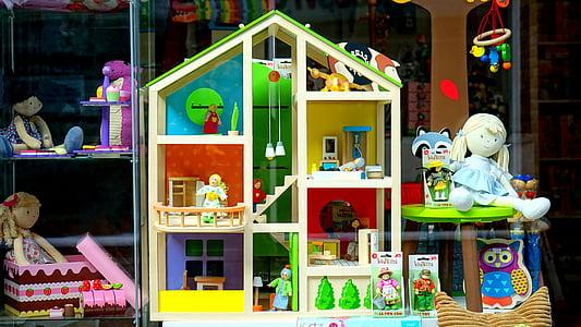 white wooden 3-storey doll house