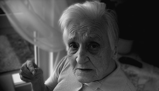 grayscale photo of man in white polo shirt