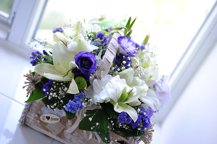 white lilies and purple roses centerpiece