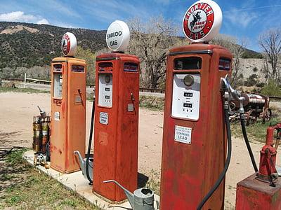 three orange gas stations