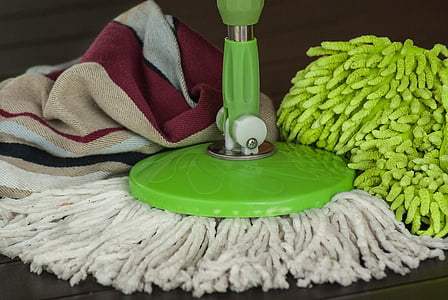white and green floor mop