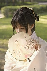 woman holding handfan