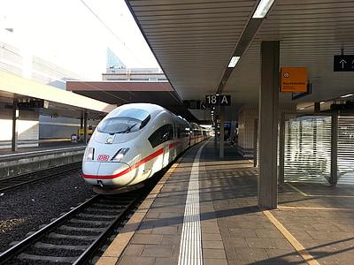 bullet train on railway during daytime
