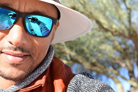 man wearing white cap and sunglasses
