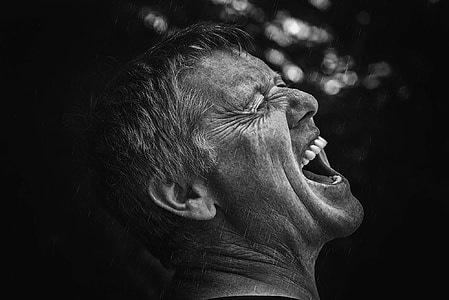 focus photography of growling man