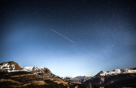 meteor shower over mountain