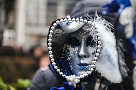 person wearing silver and blue mask
