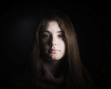 woman standing in dark
