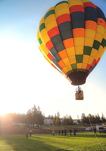 yellow and multicolored hot air balloon under blue sky