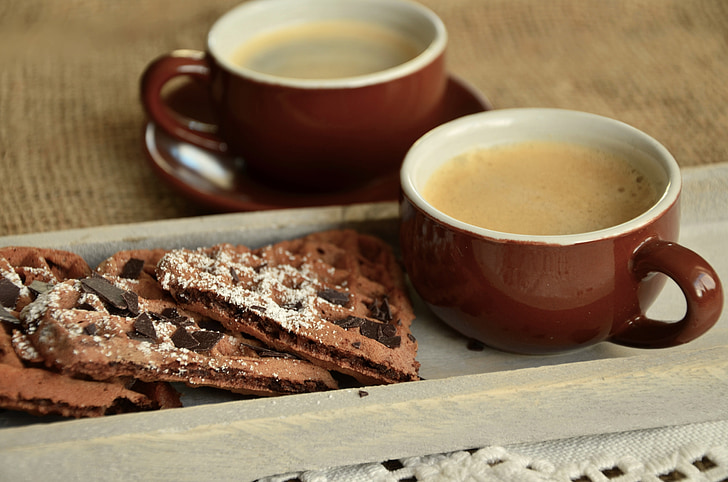Royalty-Free photo: Brown and white ceramic teacup near biscuits   PickPik