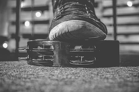 shoe on top of tambourine