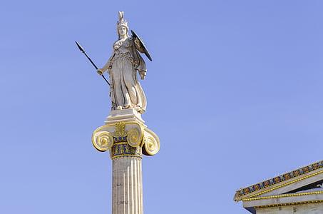knight statue under blue sky
