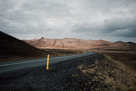 black asphalt road surrounded by mountains