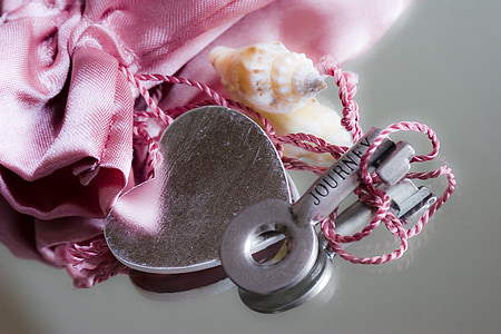 silver and pink textile