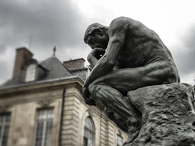 photo of thinking man statue