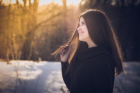 portrait photo of woman in black sweatshirt