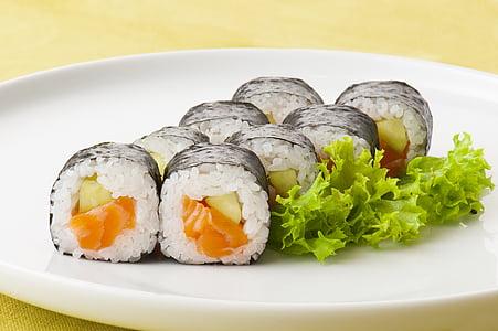 photograph of salmon maki roll