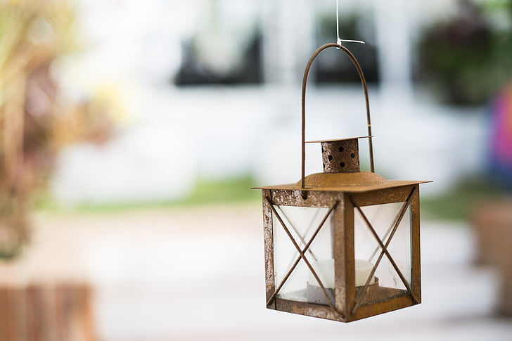 shallow focus photograph of brown candle lantern