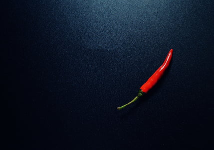 red chili on black surface