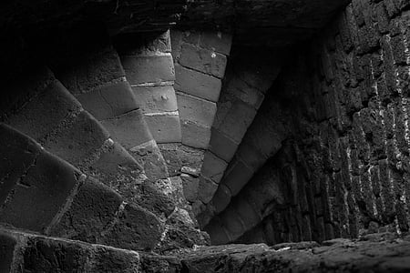 spiral concrete staircase on grayscale photography