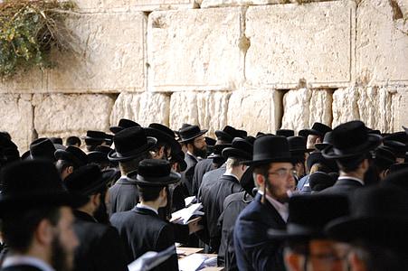 crowd of people wearing black suit and black cap