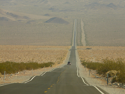 car driving on Death Valley road during daytime