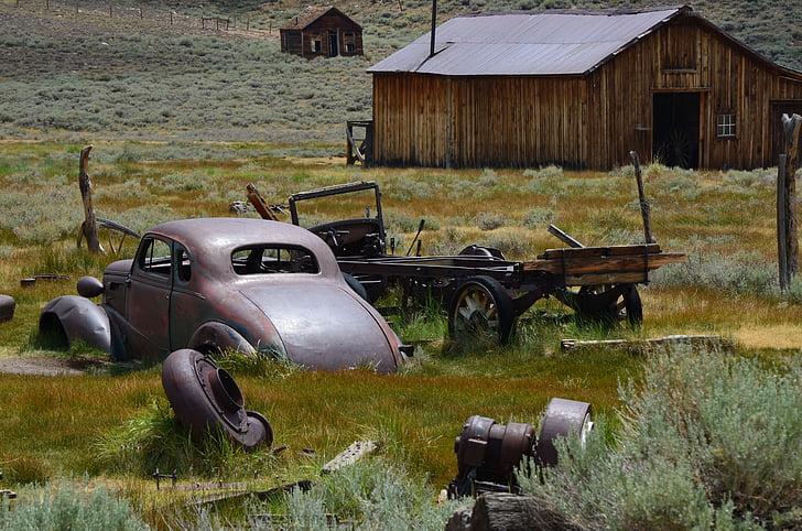 Volkswagen Beetle near shack