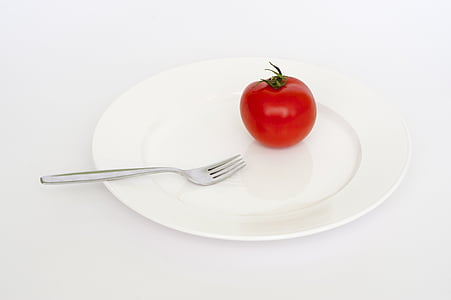 tomato on plate and fork