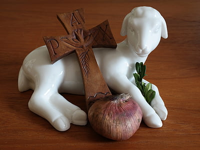 white ceramic goat figurine