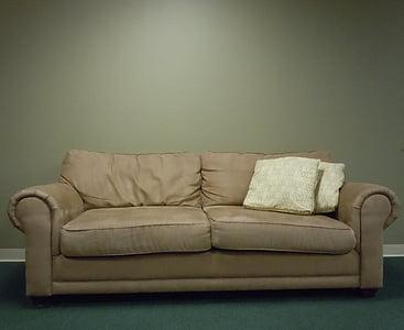 photo of beige padded 2-seat sofa near wall